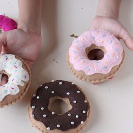 Child Holding Felt Donuts